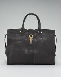 An everyday bag for today, tomorrow, and forever. Enduring leather construction and distinctive Yves Saint Laurent design is striking, yet basic enough for year-round use.Black lambskin with golden hardware.Tote handles with rings