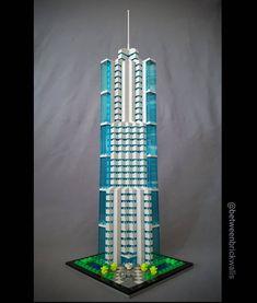 Bank Tower MOC. My (first?) entry to BriXtar and Archbrick Skyscraper Challenge. A nanoscale bank HQ with futuristic design. DBG and trans light-blue colour theme. #lego #legos #afol #moc #legomoc #legoskyscraper #legotower ##skyscraper #tower #building #legobuilding #architecture #legoarchitecture #legodesign #legobricks #contemporary #futurism #legostagram #archbrick #brixtar #challenge #legophotography #toyphotography #toys @archbrick00 @brixtar_official