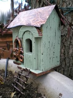 Good use of a birdhouse for your Fairy House!--I like how this one is perched on the edge of the container with a little ladder leading up to it.