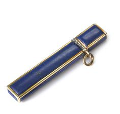A FABERGÉ CARVED LAPIS LAZULI TOOTHPICK HOLDER WITH JEWELLED GOLD MOUNTS, WORKMASTER MICHAEL PERCHIN, ST. PETERSBURG, CIRCA 1895 the rectangular gold-mounted body with rose-diamond set collar, with suspension ring, struck with workmaster's initials, KF in Cyrillic and 56 standard  Length 2 1/8 in.; 5.4 cm