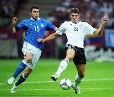 Andrea Barzagli of Italy and Mario Gomez of Germany battle for the ball during EURO 2012.