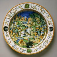 Plate with the Sacrifice of Marcus Curtius Made in Urbino, Italy, Europe c. 1560-70 Probably workshop of Guido Durantino, Italian (active Urbino), documented 1516 - 1576, or workshop of Orazio Fontana, Italian (active Urbino), c. 1510 - 1571.Tin-glazed earthenware (maiolica)1 15/16 x 17 1/16 inches. The ancient Roman legend about the self-sacrifice of a brave general, Marcus Curtius, was a popular subject in Renaissance art.