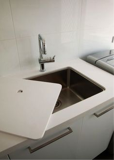Designing the ultimate laundry, all the tips and tricks you need! Make the most of limited bench space with a sink cover that acts as additional bench space when the sink isn't in use