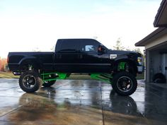 Hekka cool black and bright green ford truck with a hekka big lift!
