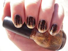 25 Cute and Creepy Nail Art Ideas For Halloween: To get this stunning, shimmery manicure, start by applying a black polish with orange glitter as a base. Next, apply a sheer, golden glitter polish over it, and finish with a glistening silver polish on the tips. Source: Flickr user Cacauate