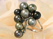 Silver ring rhodium cluster made of Tahitian pearls round nine colors ranging from gray to green, yellow and aubergine quality AB 8 mm in diameter and will fit a finger size 64