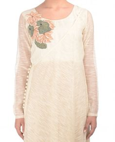 Ivory full sleeves kurta with thread embroidery adorning the right shoulder. Round neckline. This kurta comes with matching one shoulder outer slip with loop buttons at side. Wash Care: Dry clean onlyClosure: Zip at side