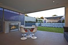 Decorative screens adds another dimension to this alfresco fireplace.  Home designed and built by Urbane Projects, Perth.