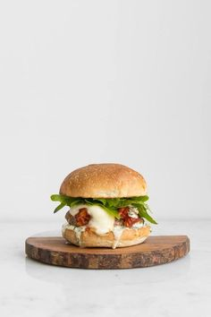 Using all the elements of the classic veal parmigiana, we have remixed this favourite Italian-American dish and taken it outdoors to the barbecue by making a juicy pork burger topped with a zesty tomato sauce, mozzarella cheese and parmigiano reggiano. #realfood #burger #pork