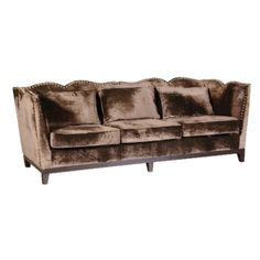 A chocolate colour 3 seat velvet sofa. Antique/vintage/modern! Love this!
