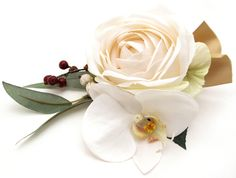 Corsage of a champagne Paris Rose, gum nuts and leaves, red berries and a phalaenopsis orchid with gold ribbon.