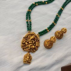 Green agate strands with dull gold Ganesha pendant & jhumka. Gold Earrings Designs, Gold Jewellery Design, Bead Jewellery, Temple Jewellery, Beaded Jewelry, Beaded Necklace, Pearl Jewelry, Bridal Jewelry, Necklaces