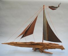 This stately matron, the Savannah Gal, named after her city of birth and namesake The Savannah Gallery, is a Siren of the sea. Born of gathered driftwood near Ft Pulaski and sails forged from 100 year old reclaimed roofing, she was the first ship created in the gallery and remains the true monarch of the sea. http://www.rlbrethauer.com/