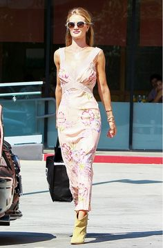 Rosie Huntington-Whiteley wears a floral tank dress, tan boots, and Jacquie Aiche necklaces