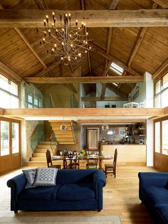 Barn conversion interior with double height living space and galleried landing Barn conversion