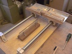Fret slot jig, with a fixed saw and the fretboard on a sled.