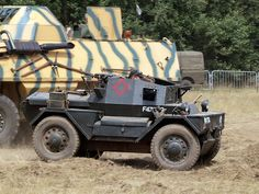 """Daimler Dingo Technical Specifications Usage [Source] The Daimler """"Dingo"""" was a light weight, four wheel drive reconnaissance vehicle used by the Commonwealth during World War II and the Korean War. Military Diorama, Korean War, Four Wheel Drive, World War Ii, 2 In, Ww2, Heavy Metal, Tanks, Armour"""