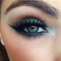 Bright aqua eye look with long lashes.