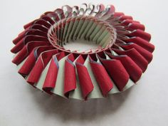 Luis Acosta - pulseras nuevas (bracelet) (mars 2013)-This may not be upcycled, but it's paper and it's great design!