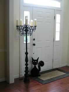 DIY- Halloween Candelabra~ Old lamp bases, a chandelier, some PVC pipe, and beads.