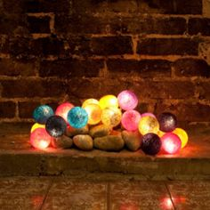 Cable and Cotton, British Design Fairy Lights & Cotton Ball Lights – Build your own set using our unique pick and mix selector, choose your own colours, assembled in the U. Cable And Cotton Lights, Cotton Ball Lights, Fireplace Filler, Fireplace Lighting, Christmas Lights, Christmas Crafts, Christmas Ideas, Unused Fireplace, Fake Fireplace