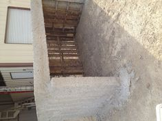 Our goat shed...made from pallets, now with first layer of papercrete.