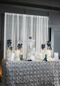 Metallic silvers and midnight blues flourished throughout the reception, giving the newlyweds a gorgeous wedding to look back at. Thank...