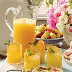 Sparkling Ginger-Orange Cocktail with grated ginger, sparkling wine, orange juice, and pineapple juice