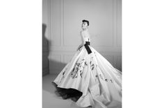 Dolce & Gabbana strapless princess gown in white satin with hand-painted roses, black tie waistband and full train.
