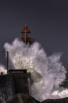 Sea Hit.  Fécamp (Normandy) Lighthouse in the Storm.