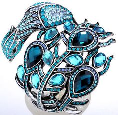 blue swarovski crystal peacock bird cuff bracelet and the best blue bling in the world! I Love Jewelry, Jewelry Box, Jewelry Accessories, Jewelry Design, Blue Crystals, Swarovski Crystals, Peacock Jewelry, Peacock Necklace, Looks Dark