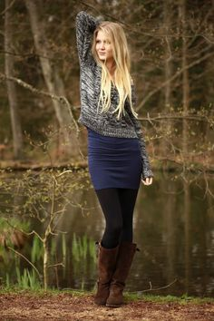 Sweater and cobalt dress with tights and brown boots
