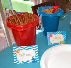 """Under the Sea Party Food!  """"Driftwood"""" Pretzel Rods and Goldfish crackers.  Tent style food label design by That Party Chick!  For details on this cute party visit www.thatpartychick.net!"""