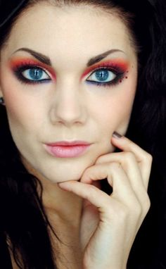 Linda Hallberg, makeup artist. Bright orange red eyeshadow, a hint of sparkle, perfect skin, and soft pink lipstick. Great look for summer.