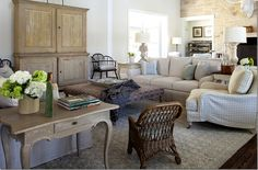The checks in soft blues mixed with the khaki linens add a unifying design factor to the large house – another lesson learned here.  By using the same basic colors and patterns throughout – the rambling house seems connected and cohesive.   Another design lesson from Ginger.