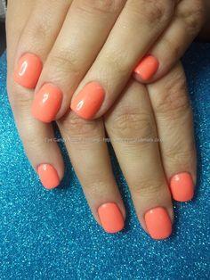 Orange gel polish on acrylic nails