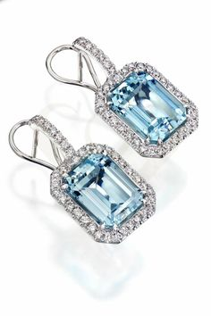Aquamarine earrings with diamonds.