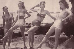 "Models wearing ""California"" bathing suits, with no shoulder straps and minimum diaper-style pants, 1945, photo by Walter Sanders"