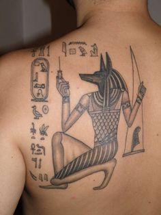 http://www.tattoobite.com/wp-content/uploads/2013/12/egyptian-anubis-tattoo-design-on-back-shoulder.jpeg