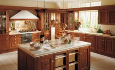 Baltimora Cherry wood kitchen.  Traditional solid wood doors Available from Stoneworld Kitchens Thame