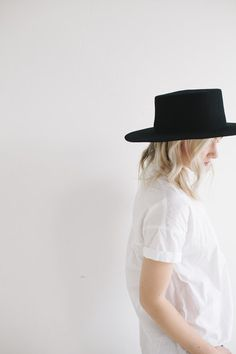"The Dahlia is a super stiff women's rancher felt hat. Often referred to as a women's ""Boater"" hat with its flat crown. This classic black is a staple has a spot in every closet, as it will carry over"