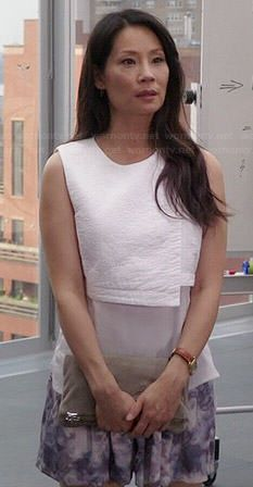 Joan's white textured layered top and blue printed shorts on Elementary.  Outfit Details: https://wornontv.net/40441/ #Elementary