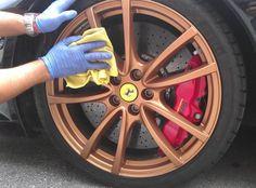 GeoWash operator cleaning a golden Ferrari rim