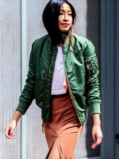 Go for an unexpected look by pairing a Green Bomber Jacket with an Orange Pencil Skirt