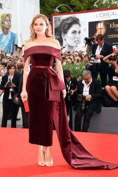 Pin for Later: See All the Best Dressed Stars at the Venice Film Festival Diane Kruger At the premiere of Black Mass Diane stunned in a burgundy Boss dress with a bow train.
