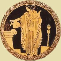 Priestess offering sacrifice in the altar, attic red figured cup