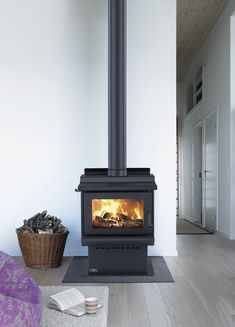 Free standing radiant wood burner with cook top. A compact unit, designed to heat homes with medium to large living areas. Flue kit and shield sold separately.      Durable 6mm steel fire box.     Stainless steel (304 grade) baffle for longer service life.     Super tough 5mm robax ceramic glass.     Easily maintained high temperature painted finish.     Functional cook top. Wood Burner Fireplace, Modern Barn House, Stainless Steel 304, Living Area, Firewood, Home Appliances, House Design, Metal, House Ideas