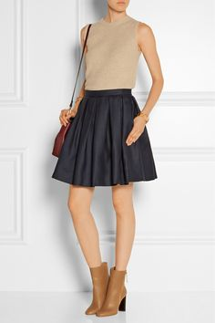 BURBERRY LONDON Pleated wool and silk-blend mini skirt THE ROW Tippi ribbed merino wool top BURBERRY SHOES & ACCESSORIES Leather ankle boots ANTIK BATIK Sonoma beaded canvas shoulder bag