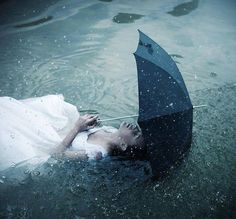 I lie in bed for hours, a clamp around my heart, listening to the rain against the window pane. I can't stand the grey sky, and so I turn my face to the wall and sink into a darker place. Let me drown. I don't wish to return to the surface. - Unknown  Photo by Nicholas Javed Photography