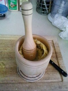 """A wooden Mortar and Pestle """"Pilón""""    A mortar is a centuries old kitchen essential for grinding together spices to enhance the flavor of your cooking. Today I still use this, great to crush garlic."""